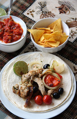 Mexican food with tortillas and nachos .
