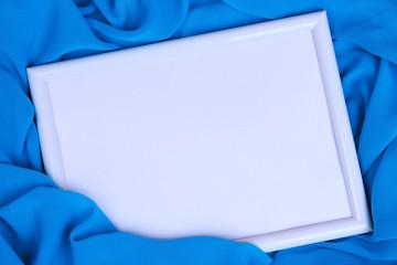 Empty frame on beautiful silk background