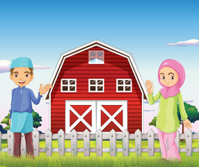 A male and a female muslim in front of a barnhouse