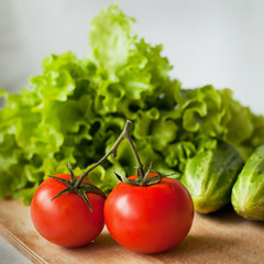 tasty tomatoes, cucumbers and salad on the kitchen