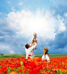 Happy ukrainian family on the field