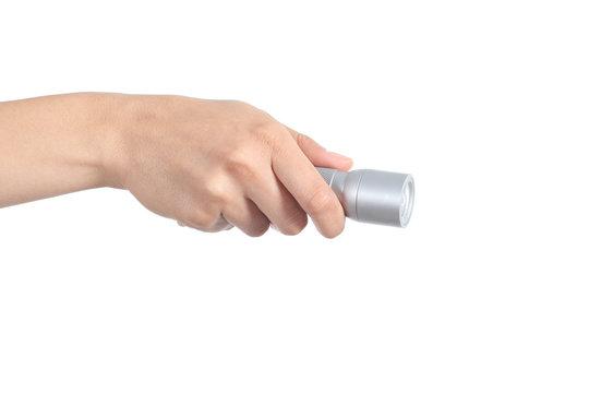 Woman hand holding a flashlight