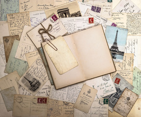 old postcards and open book. nostalgic vintage background
