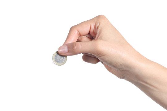 Woman hand putting an euro coin