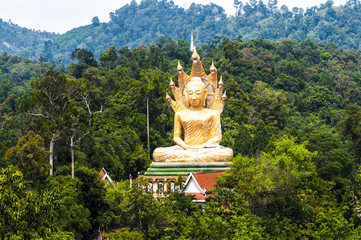 Golden Buddha statue surrounded by mountains