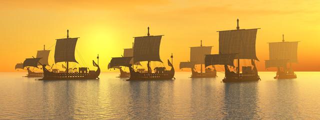 Alte römische Kriegsschiffe vor Sonnenuntergang