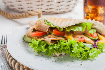 Kebab in pita bread close-up