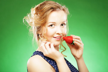 beautiful blond  holding a strawberry