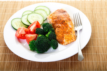 Dinner of Baked Salmon and Fresh Vegetables