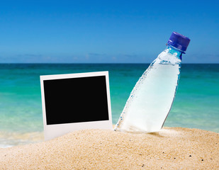 photo frame and a bottle of drinking water