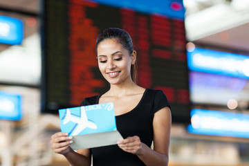 young business woman looking at air ticket
