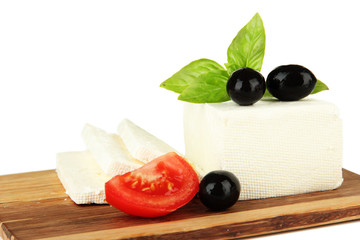 Sheep milk cheese with basil  and black olives, tomato