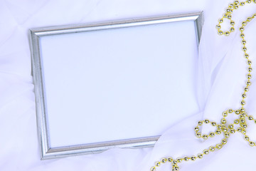 Empty frame on beautiful silk background