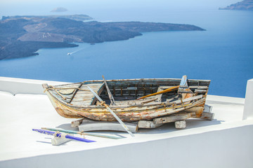 Famous old boat on the roof of house in Santorini island in