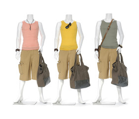Full length three male mannequin dressed with bag
