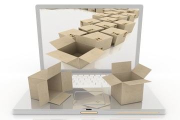 Open laptop and piles of cardboard boxes