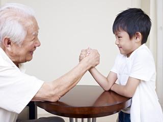 grandpa and grandson hand wrestling