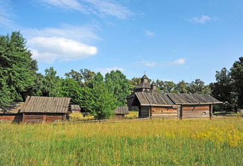 Ancient traditional ukrainian rural wooden barn and church