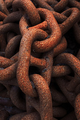 closeup of metallic and rusty chains