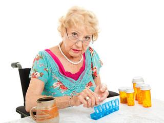 Senior Woman Sorting Pills