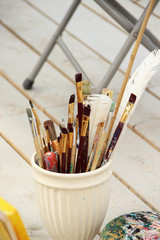 Vivid paintbrushes at the atelier