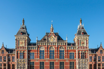 Facade of the ancient central train station in Amsterdam