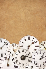 Set of vintage white clock faces on an ancient background