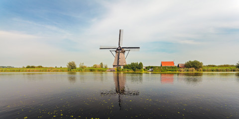 Panoramic view of a Dutch windmill at Kinderdijk