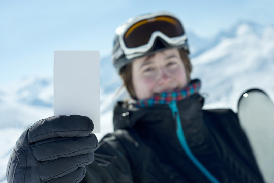 Winter sport atlethe showing lift pass