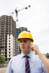 man in a hard hat talking on the phone