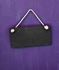 blackboard hanging on the door