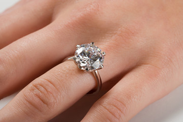 A woman wearing an engagement ring