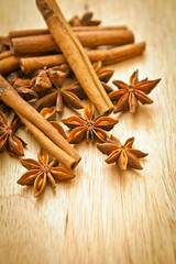Vanilla sticks and star anise on a wooden board