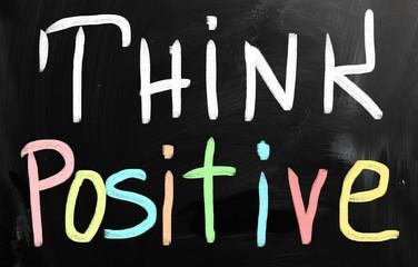 """Think positive"" handwritten with white chalk on a blackboard"