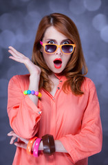 Surprised redhead girl in sunglasses
