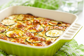 Photo Stands Ready meals casserole with cheese and zucchini in baking dish