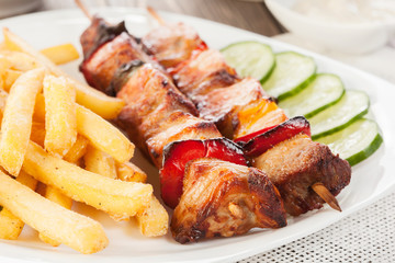 Grilled shashlik with french fries
