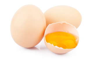 Chicken raw eggs, whole and broken on white, food photo