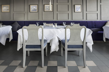 Grey chairs and tables setting at restaurant.