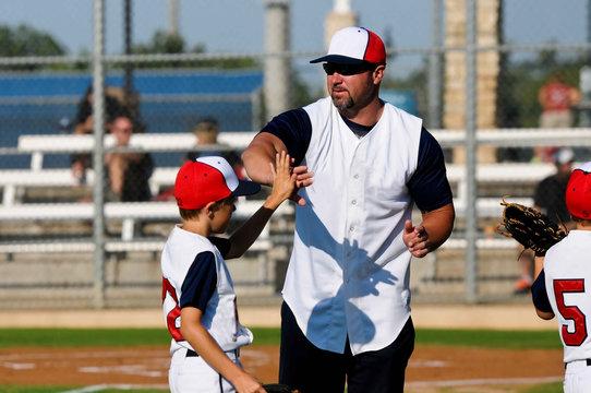 Little league baseball boy with coach