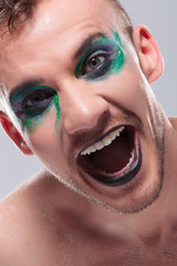 casual man with makeup laughs out loud