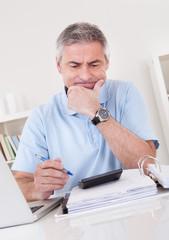 Mature Man Doing Finances