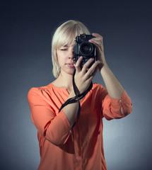 Woman with retro camera.