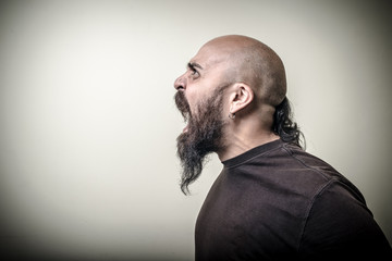 profile screaming angry bearded man