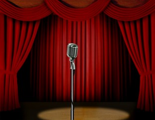 Retro microphone and red curtain on a stage with spotlight