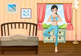A girl doing yoga near her bedroom