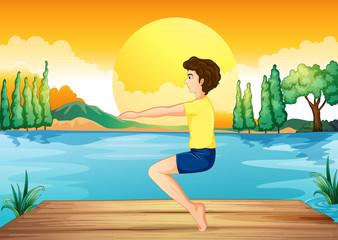 A boy exercising near the deep river