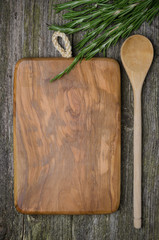 vintage cutting board with space for text, spoon, fresh rosemary