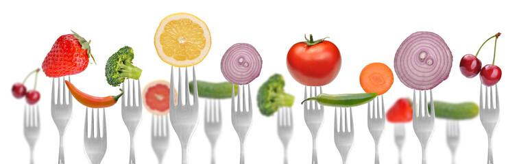 diet concept.vegetables and fruits on the collection of forks