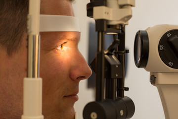 Patient at slit lamp of optician or optometrist